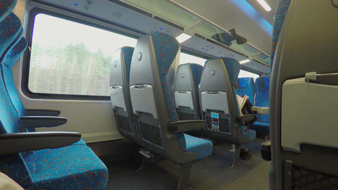 Many empty seats on comfortable intercity express train moving at high speed Footage