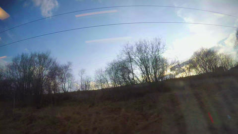 Timelapse of landscapes, railway stations, towns, sky seen through train window Footage