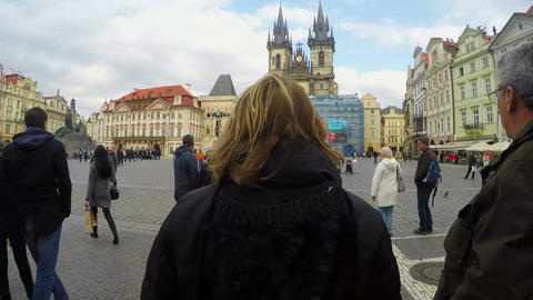 Many tourists on central square in Prague downtown, sightseeing tour, timelapse Footage