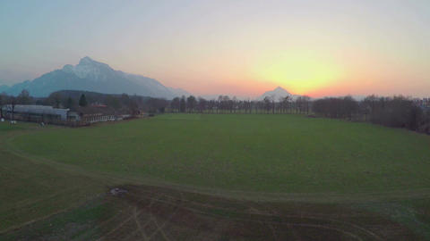 Beautiful sunrise behind mountain silhouette shot by drone, peaceful nature Footage