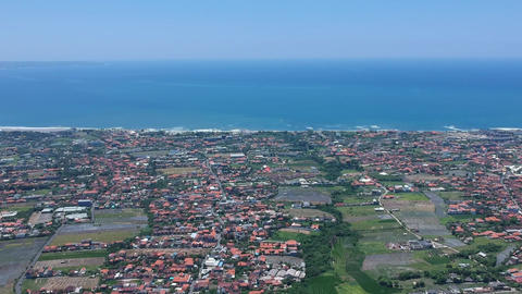 Changu from above in sunny weather Bali Indonesia, visible red roofs, green rice Live Action