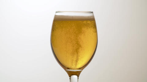 Beer into transparent glass, froth and bubbles Live Action