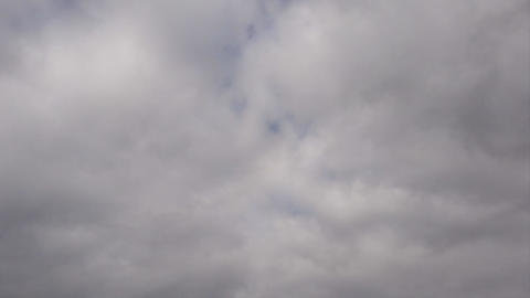 Time lapse nimbostratus grey clouds over blue sky background blurred with amorphous smoky clouds Live Action