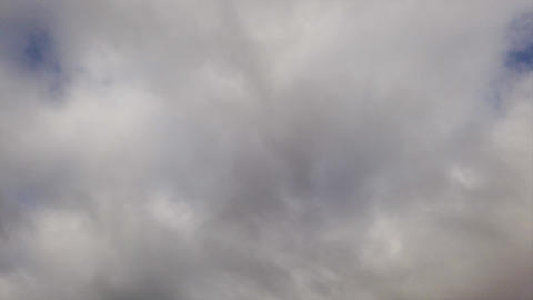 Time lapse sky with amorphous gray nimbostratus clouds blow from left to right in ominous foggy sky Live Action