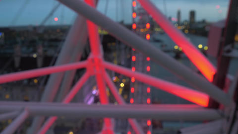 Evening illumination London Eye in red, close up Live Action