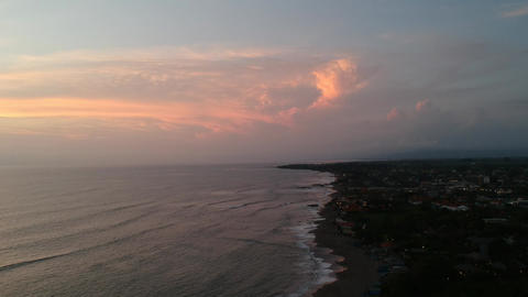 landing of the drone at sunset is visible half of the ocean and half of the Live Action
