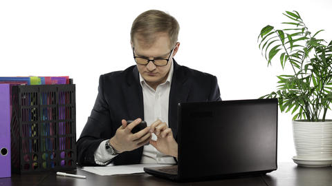 Businessman working in office. Manager talking on telephone. Sitting at office Live Action