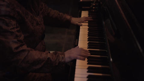 Witch plays the piano. Witches fingers play the keys on the piano Live Action