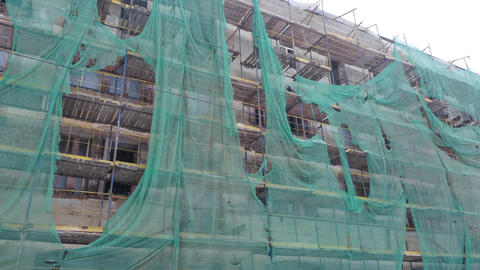 Renovation works on the facade of the old building Live Action