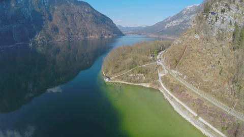 Aerial view of serpentine railroad at mountain bottom, beautiful lake, tourism Live Action