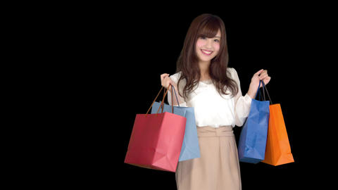 Young Japanese woman shopping with colorful bag 2 Footage