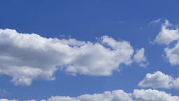 Cloudscape time-lapse 4k video: rolling cumulus clouds moving blue sky sunny day Footage