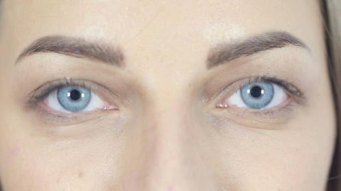 Close Up Of Blinking Eyes Looking At Camera, White Background Footage
