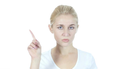 Woman Showing No by Waving fingers, White Background Footage