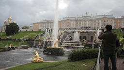 man taking photos of the Grand palace fountains in Peterhof St.Petersburg, Russi Footage