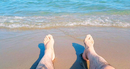 man in relax stay with his feet on tropical caribbean beach sea with gold sand, holiday, relax and Live Action