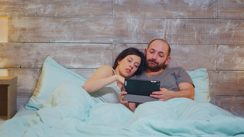 Caucasian couple in pajamas lying in bed Live Action