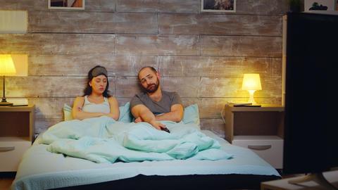 Caucasian couple using tv remote control Live Action