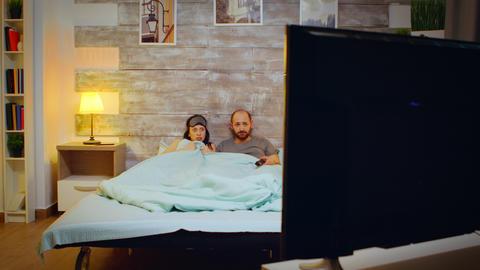 Zoom in shot of boyfriend and girlfriend in bedroom Live Action