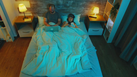 Top view of young couple under the sheets Live Action