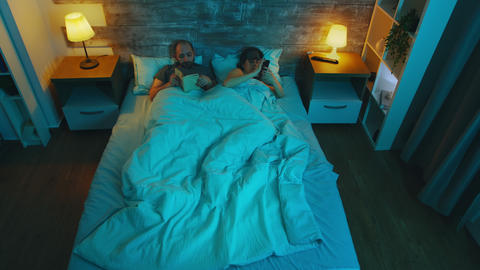 Top view of young woman in the bedroom with her husband Live Action