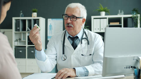 Experienced doctor talking to unhealthy girl discussing health with patient in Live Action