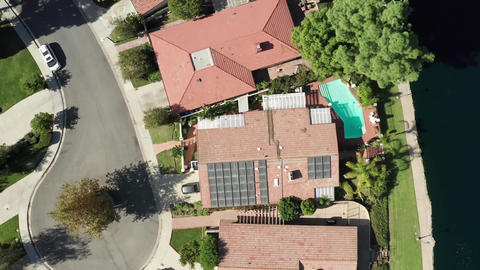 Aerial View of Luxury House With Solar Panel Array on Rooftop by Calabasas Lake Live Action