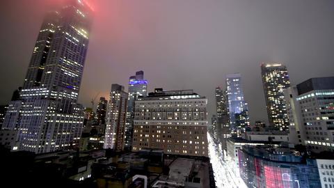 NEW YORK CITY - DECEMBER 2018: New York City midtown skyline at dark with Empire Live Action