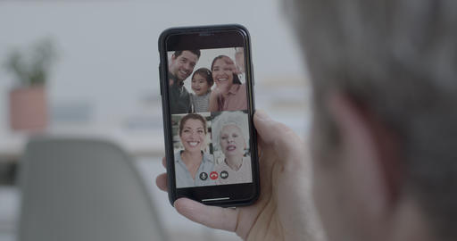 Family on video call at home during social distancing using smart phone and video conferencing Acción en vivo
