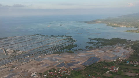 view of fish farms from the drone and salt mining in sunny weather Pejarakan Live Action