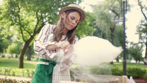 Video theme is a small business cooking sweets. A young caucasian woman with an Live Action