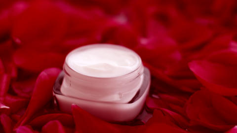 Jar of face cream moisturizer and flower petals, luxury skincare and cosmetics Live Action