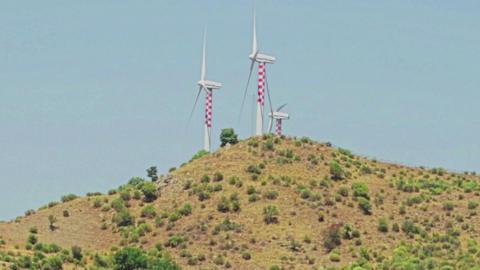 wind turbine alternative renewable energy on hills background Live Action