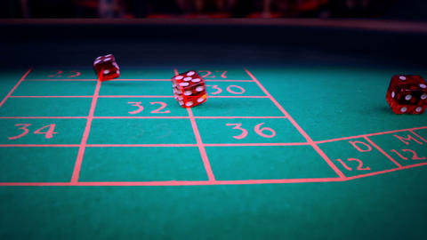 three red dice rolling on green game gambling table,…, Live Action