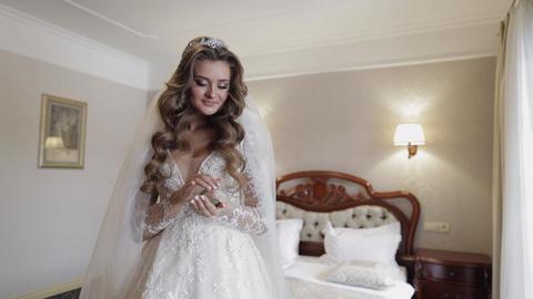 Beautiful, lovely bride in wedding luxury dress, veil. Wedding bouquet in hands Live Action