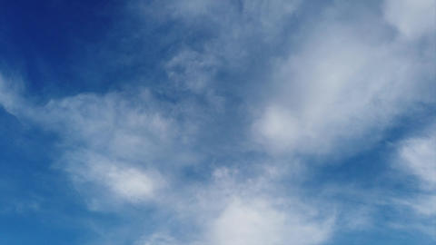 Awe time lapse cirrus fluffy white clouds in a beautiful blue summer sky Live Action
