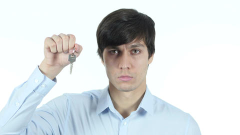 Businessman Showing Keys of House, White Background Footage