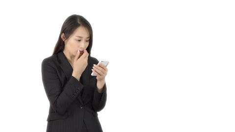 Young Japanese business woman texting on iphone 2 Footage