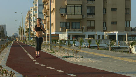 Attractive young woman doing morning run, taking care of her body and health Footage