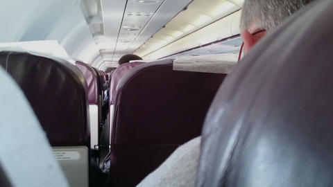 Passenger hiding behind seat during terror attack on plane. Aircraft hijacking Footage