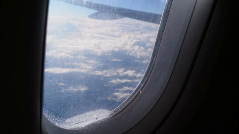 Passenger plane flying high. Person saying goodbye to motherland, tears on glass Footage
