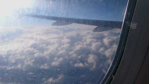 Aircraft drifting down in stormy clouds before landing at destination airport Footage