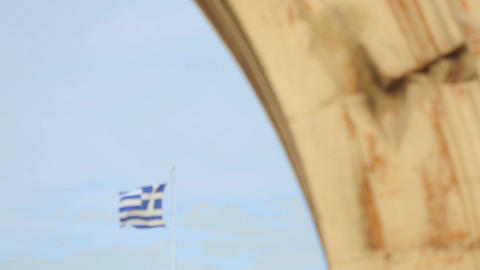 Greek national flag over Acropolis in Athens, many people, debt crisis in Greece Footage