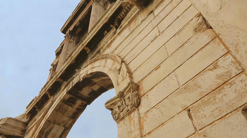 High marble wall of antique Hadrian's Gate in Athens, old historical monument Footage