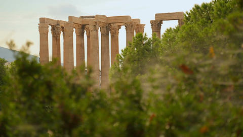 Ruins of greatest temple in ancient Greece, ancient site seen through bushes Footage