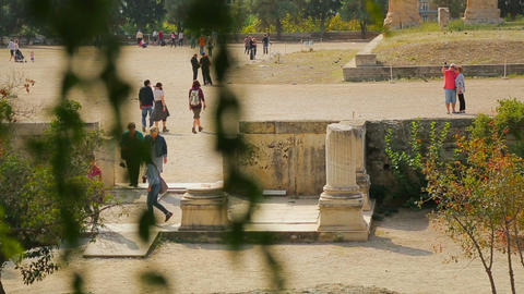 Crowd of people walking, taking pictures at ancient ruins, tourist attraction Live Action