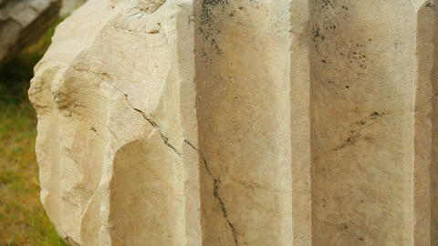 Closeup shot of processed marble stone, piece of antique column, ancient ruins Footage