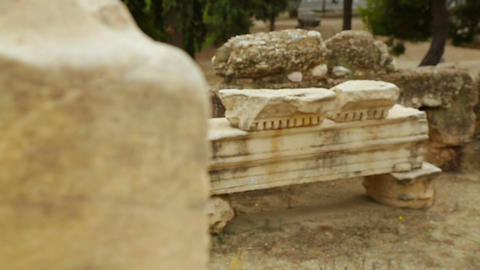 Rack focus shot of antique marble construction remains, archaeological finds Footage