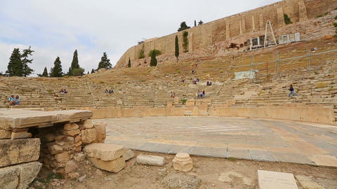 Ruins of ancient theater on the slope of Acropolis, tourist attraction in Greece Live Action
