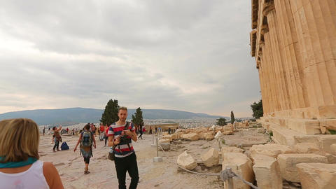 Person looking at remains of ancient temple Parthenon, place of tourist interest Live Action